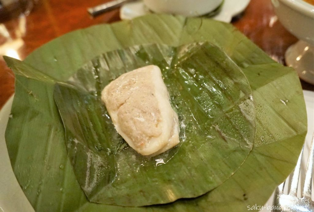 Steamed snow fish, northern style crab paste fresh herbs in banana leaves